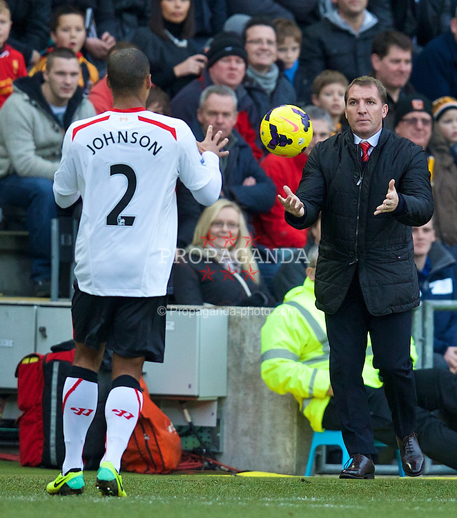 HULL, ENGLAND - Sunday, December 1, 2013: Liverpool's manager Brendan Rodgers throws the ball back for Glen Johnson during the Premiership match against Hull City at the KC Stadium. (Pic by David Rawcliffe/Propaganda)