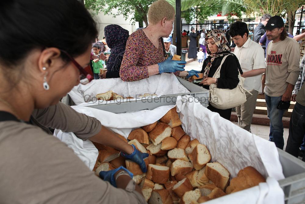 Greek and Nigerian volunteers distributing bread
