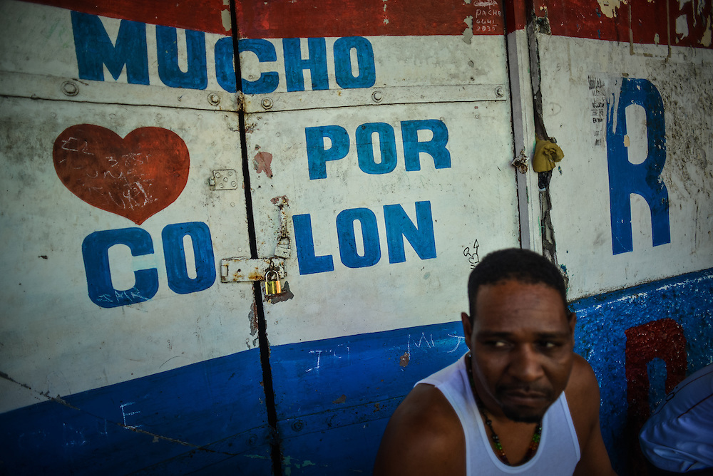 """Doors painted with """"Much love for Colón"""" written in Spanish at the entrance to the Wilcox building, which was once an architectural landmark in Colón, is now a condemned building, notorious for being a violent crime hub in the city, with over 100 squatters living inside. Despite being the second largest city in Panama, Colón is one of the poorest in the region, and its residents suffer from a critical shortage of potable water, sewer connections and housing--many people live in condemned or should be condemned buildings. Panama is now one of the fastest growing countries in Latin America and there is a growing resentment and impatience that Colón has not reaped as much of the benefit as Panama City."""