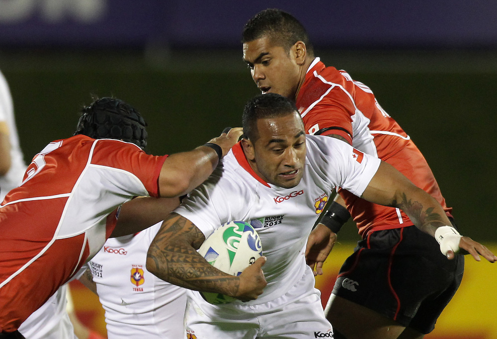 Tonga's Fetu'u Vainikolo is tackled by Japan's Kensuke Hatakeyama  and Sione Talikavili Vatuvei during a Pool A match of the Rugby World Cup 2011, Northland Events Centre, Whangarei, New Zealand, Wednesday, September 21, 2011.  Credit:SNPA / David Rowland