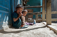 """A child gives a """"namaste,"""" a traditional greeting, in the village of Giabong in the Ropa Valley, Himachal Pradesh, India"""
