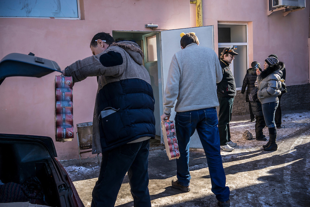 Volunteers unload canned goods at a processing center for people displaced by the conflict in Eastern Ukraine on Wednesday, February 11, 2015 in Kharkiv, Ukraine.