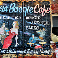 Rum Boogie Cafe Mural on Beale Street in Memphis, Tennessee<br /> Since 1985, the Rum Boogie Cafe on Beale Street in Memphis has served rum with its catfish, ribs, gumbo and red beans to their toe-tapping patrons while they listen to live blues bands. Their motto is, &ldquo;Eat, drink, boogie and repeat.&rdquo; When you go, check out this Rum Boogie Cafe mural in the alley. Then go inside to see their collection of 150 guitars.