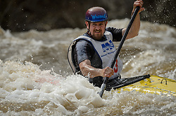 Bill Miles of Cuba, Mo. races in the K1 Men's Expert class on the slalom course of the 45th Annual Missouri Whitewater Championships. Miles placed third in the class, first in the C1 Men's Plastic class, first in the downriver C-1 class and second in the K1 Men's Long Plastic (30 and up) class. The Missouri Whitewater Championships, held on the St. Francis River at the Millstream Gardens Conservation Area, is the oldest regional whitewater slalom race in the United States.  Heavy rain in the days prior to the competition sent water levels on the St. Francis River to some of the highest heights that the race has ever been run. Only expert classes were run on the flood level race course.