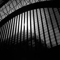 Canary Wharf Docklands Light Railway Station structure in Silouette with sun in the picture
