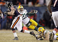 Green Bay's Charles Woodson and Clay Matthews tackle Chicago's Matt Forte.The Green Bay Packers traveled to Soldier Field in Chicago to play the Chicago Bears in the NFC Championship Sunday January 23, 2011. Steve Apps-State Journal.