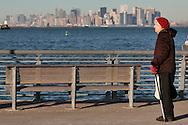 PHOTO PETER PEREIRA/4SEE<br /> <br /> Evelyn Fanke, who got a new heart on September 11, 2001, takes a break as she walks home in Staten Island, in the background NYC can be seen.  New Yorkers deal with the 10th anniversary of September 11, 2001 in different ways.