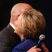 Democratic Presidential Candidate HILLARY CLINTON hugs Delaware Governor Jack Markell prior speaking to supporters one day before Delaware's Tuesday primary's Monday April. 26, 2016, at World Café Live at the Queen in Wilmington Delaware.