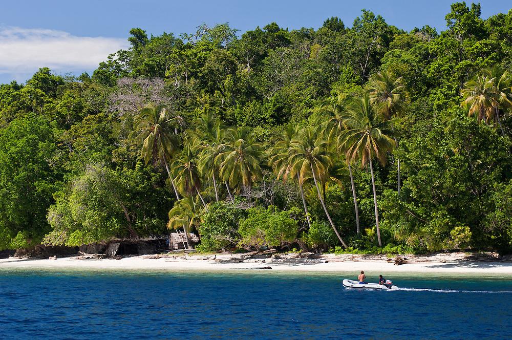 Tourists exploring the coastline of a remote island, Rurbas, West Papua, Indonesia.