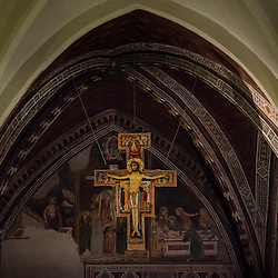 "Lisa Johnston | lisajohnston@archstl.org The crucifix known as the San Damiano cross hangs in the Basilica of St. Clare in Assisi.  It is the crucifix that ""spoke"" to St. Francis as he heard Christ say to him, ""Help me rebuild by Church""."