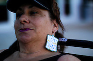"""Shelly Wright is third in line with homemade earrings for casting for season 11 of """"The Biggest Loser"""" television show in Broomfield, Colorado July 17, 2010. Wright spent the night on the sidewalk outside the hall for a chance to be on the show and win $250,000.  Over 600 people attended the casting call.   REUTERS/Rick Wilking (UNITED STATES)"""