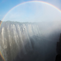 Africa, Zambia, Mosi-Oa-Tunya National Park,  Rainbow above Eastern Cataract of Victoria Falls