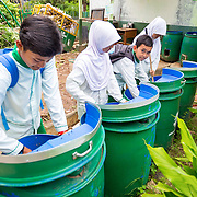 CAPTION: Students and teachers have been trained on how to use organic waste to make compost. Any excess is sold as fertiliser, and the profits generated go towards building a school garden. LOCATION: SMP N 7 School, Bandar Lampung, Indonesia. INDIVIDUAL(S) PHOTOGRAPHED: From left to right: Muklis Bima In, Dwi Wijayanti, Yoato Arfiru Serua and Putri Aryanti Fadillah.