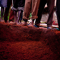 Relatives bury a man on May 18, 2010 who was ambushed and murdered by LRA forces while driving an eduction minister from Yambio to Tambura.
