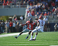 Ole Miss' Nickolas Brassell (2) catches a pass vs. Arkansas safety Tramain Thomas (5) at Vaught-Hemingway Stadium in Oxford, Miss. on Saturday, October 22, 2011. Arkansas won 29-24..
