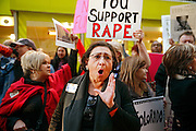"""DENVER, CO -  JANUARY 17: Protestor Lucilla Tenorio of Denver, Colorado shouts """"Skip the show!"""" while demonstrating outside of Bill Cosby's comedy show at the Buell Theater in Denver, Colorado on January 17, 2015. Cosby has been facing allegations by numerous women who claim the comedian drugged and subsequently sexually assaulted them. (Photo by Marc Piscotty/ © 2015)"""