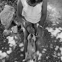 Girl Playing with dog, Chetumal, Mexico