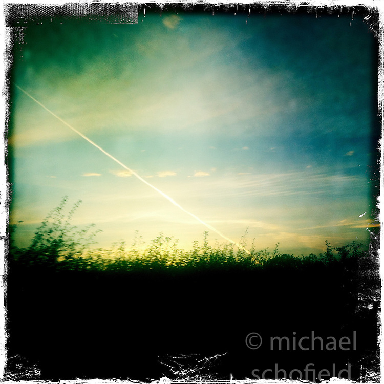 Plane trails..Hipstamatic images taken on an Apple iPhone..©Michael Schofield.