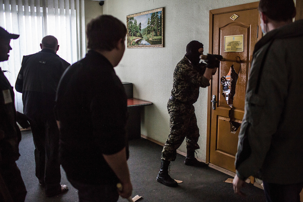 DONETSK, UKRAINE - MAY 4: Pro-Russian protesters occupy and ransack the military prosecutor's office on May 4, 2014 in Donetsk, Ukraine. Cities across Eastern Ukraine have been overtaken by pro-Russian protesters in recent weeks, leading the Ukrainian military to respond with force in some areas. (Photo by Brendan Hoffman for The Washington Post)