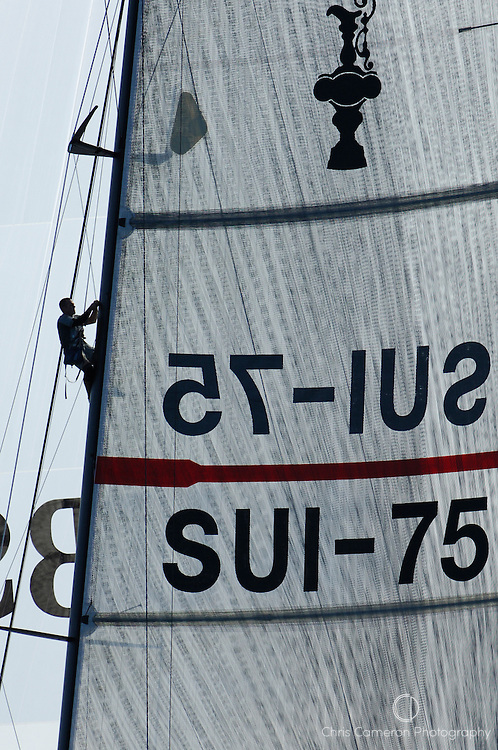 An Alinghi crewman working up the mast on SUI75. Louis Vuitton Act 6. Malmo, Sweden. 30/8/2005