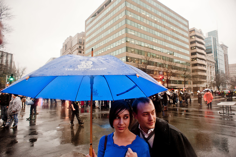 Lisa Banusiewicz, 24, and Vince Natale, 24, both of Washington, watch the Occupy K St. protest from the groundlevel on their lunch break on Wednesday, Dec. 7, 2011 in Washington.  (Photo by Jay Westcott/Politico)
