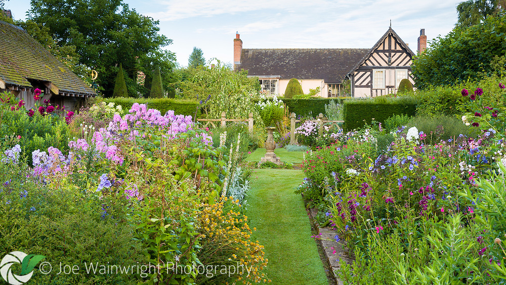 The 16th century Wollerton Old Hall, viewed from the nearby Sundial Garden - photographed in July