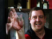 "04/06/2010 - Adam ""Thorn"" Smith, who will compete next week in the Oregon open dart tournament, practices at the newly opened Lucky Labrador Tap Room. He is with the dart team the Portland Thorns.."