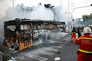 Many public buses were commandeered by 'Red Shirts' and driven at government forces before being set alight to form burning barricades...Violence between the 'Red Shirts' of the UDD and police / government military forces on the city streets of Bangkok. The UDD (United Front for Democracy Against Dictatorship) says Prime Minister Abhisit Vejjajiva came to power illegitimately and is a puppet of the military. The movement is made up of supporters of former Prime Minister Thaksin Shinawatra who was ousted in a coup in September 2006. The UDD wants Mr Abhisit to resign and call fresh elections.