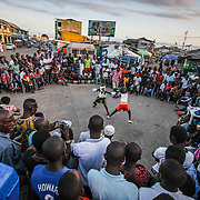 Two teenage boxers square off during one of the regular Sunday street fights in Bukom, an impoverished neighborhood in downtown Accra, Ghana. Boxing is a huge element of the indigenous Ga people's culture, and many young children learn to fight barefoot in the street. June 21, 2015