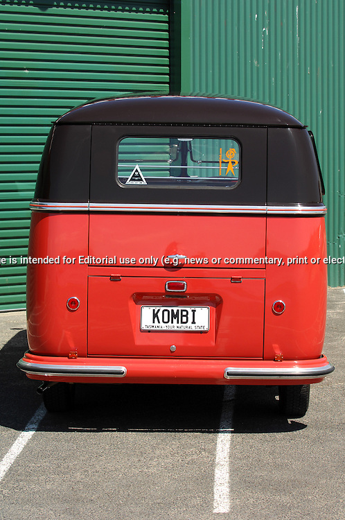 1955 Volkswagon VW Kombi Bus.Chestnut Brown & Ceiling Wax Red.Sandy Bay Rowing Club.Sandy Bay, Hobart, Tasmania .16th February 2008.It was built in the Wolfsburg Factory in Germany on 23rd of March 1955. It is a very rare bus indeed, as they were not built in that factory for very long. Less that 6 months of production. It is one of the earliest 55s in the world. It is specked as a Deluxe, with all genuine original parts (No reproduction parts used, apart from side step). It is running 1968 lowered beam & brakes It is also running a 1641 Remtec motor; with twin type 3 carbs, an L-Bug gearbox & IRS suspension. .(C) Joel Strickland Photographics.Use information: This image is intended for Editorial use only (e.g. news or commentary, print or electronic). Any commercial or promotional use requires additional clearance.
