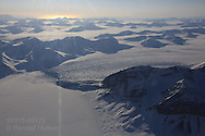 Aerial view over Isfjorden of Borebreen glacier covered in snow in April on flight from Longyearbyen to Ny-Alesund; Svalbard, Norway.