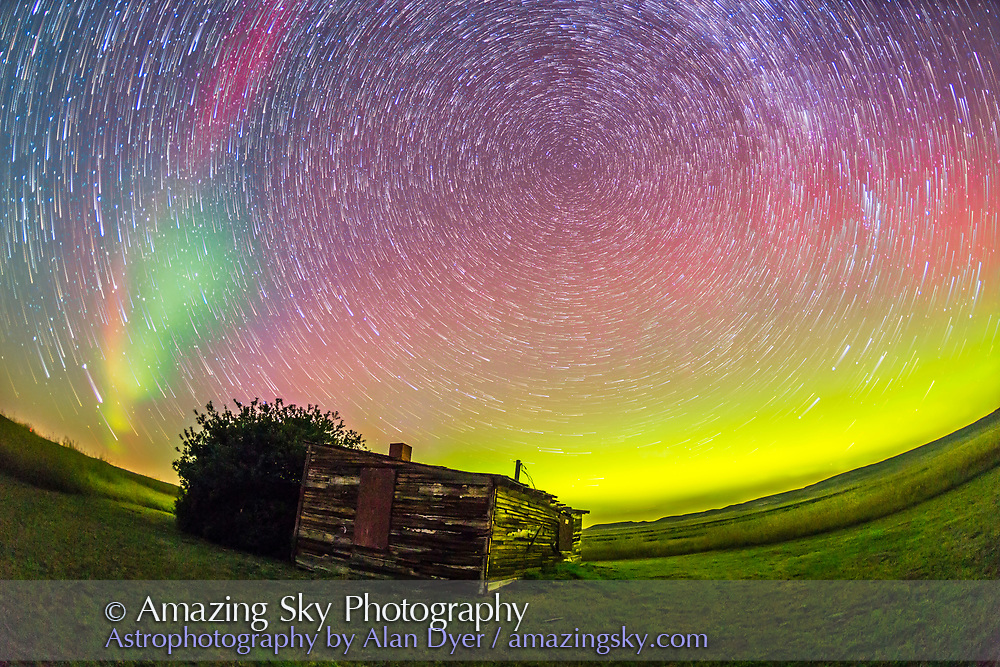 A circumpolar star trail composite, shot at the old Larson Ranch site in the Frenchman Valley at Grasslands National Park, Saskatchewan, August 27/28, 2014. The pioneer cabin was the home of the legendary western author and movie star Will James, born Ernest Dufault in Quebec. He lived in this cabin when he worked the ranches in the area. The aurora was excellent this night. This is a stack of 20 1-minute exposures at ISO 2500 with the 15mm full-frame fish-eye lens at f/3.2 and the Canon 6D. The foreground and point-like stars are from the first frame in the series.
