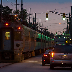 Using a bit of street running, an electric South Shore commuter train continues its journey to Chicago after its brief stop in Michigan City, IN.