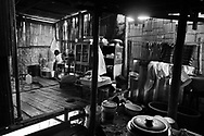 Inside a house in the Lahu village. The kitchen is on the left side and the right serves as the washing area, where the inhabitants of the house both shower and do the dishes.