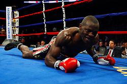 Dec 11, 2008; Newark, NJ, USA; Steve Cunningham gets knocked down during his 12 round bout against Tomasz Adamek at the Prudential Center. Adamek captured the belt via 12 round split decision.