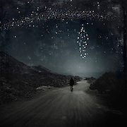 Surreal nightscape with stars forming the form of a person - manipulated photograph<br />