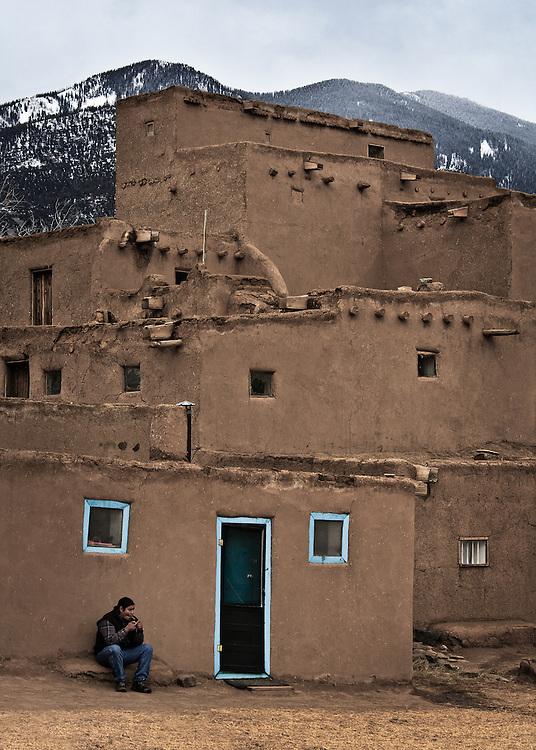 Man smoking...Taos Pueblo, New Mexico.