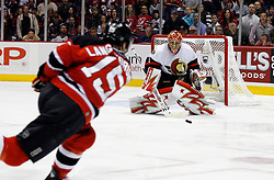 April 28, 2007; East Rutherford, NJ, USA; New Jersey Devils right wing Jamie Langenbrunner (15) takes a shot on Ottawa Senators goalie Ray Emery (1) during the first overtime period of game two of the 2007 NHL Eastern Conference semi-finals at Continental Airlines Arena in East Rutherford, NJ.