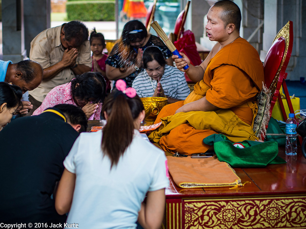14 JANUARY 2016 - CHACHOENGSAO, CHACHOENGSAO, THAILAND: A Buddhist monk blesses people who made merit at Wat Sothon. Wat Sothon, in Chachoengsao, is one of the largest Buddhist temples in Thailand. Thousands of people come to the temple every day to pray for good luck, they make merit by donating cooked eggs and cash to the temple. The temple dates from the Ayutthaya period (circa 18th century CE).           PHOTO BY JACK KURTZ
