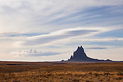 Shiprock rises above the arid desert plains of northwest New Mexico in the Four Corners region of the southwest United States.
