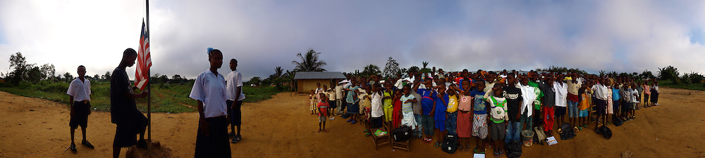 The pupils of J.S. Varfley School during the rising of the Liberian flag, Kingsville #7, Liberia.