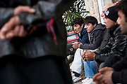 Afghani's wait on the side of the road to be picked up for work from the  locals of Lesvos island.  Image © Angelos Giotopoulos/Falcon Photo Agency..