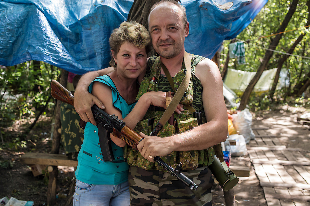 Zhenya, a pro-Russia rebel, and his wife Ira, a camp cook, at a camp by a checkpoint on the outskirts of the city on Monday, July 28, 2014 in Horlivka, Ukraine.