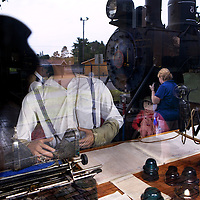 Reflection in the window of the train depot display at the Rhinelander Logging Museum Complex.