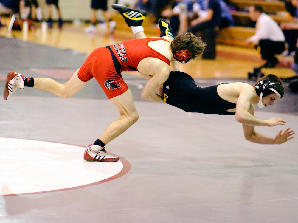 (staff photo by Matt Roth)<br /> <br /> Glenelg 130 weight Zach Gerber slams South Carroll's Daniel Peters to the mat. Gerber won the match 14-3. Glenelg defeated South Carroll in the 1A/2A State Duals semifinals but lost the championship meet to Bel Air 29-23.