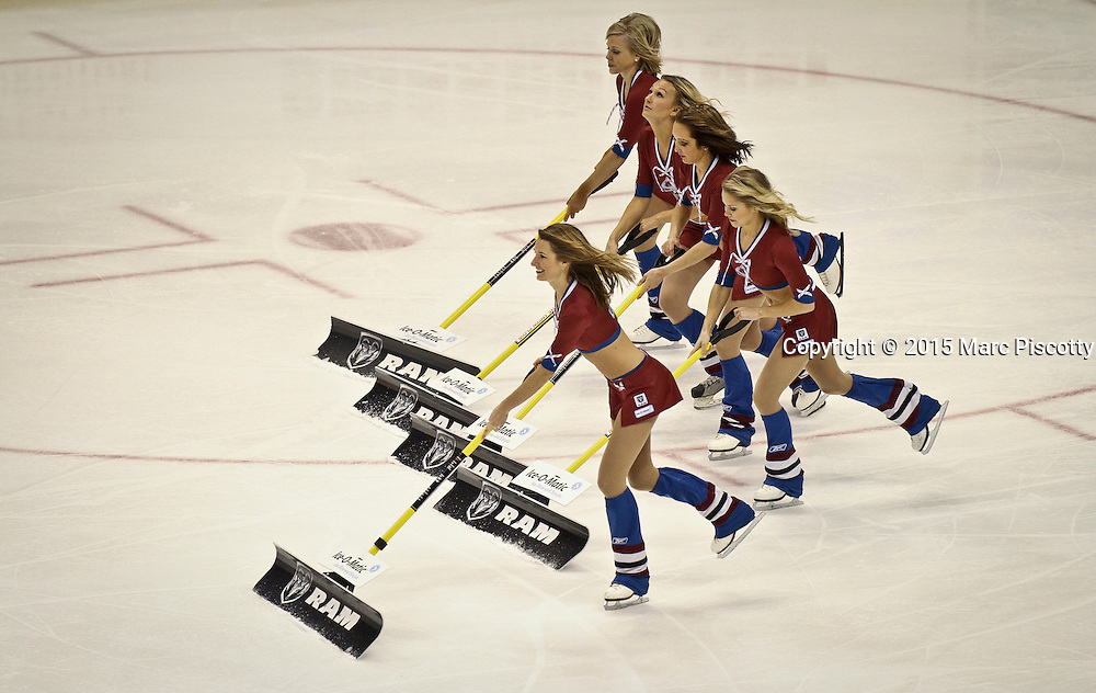 SHOT 1/10/15 2:12:36 PM - Colorado Avalanche Ice Girls sweep the ice during a break in the action as the team played the Dallas Stars during a regular season game at the Pepsi Center in Denver, Co. Colorado won the game 4-3.  (Photo by Marc Piscotty / © 2015)