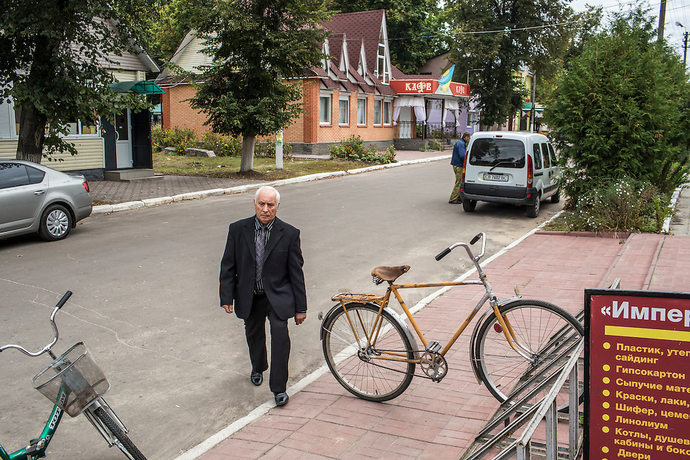 SEMYONOVKA, UKRAINE - SEPTEMBER 13, 2015: Ivan M. Papchenko, 67, secretary of the local Communist party, in Semyonovka, Ukraine. A statue of Vladimir I. Lenin, which was taken down from the town square in the immediate aftermath of the collapse of the government of President Viktor Yanukovych in February 2014, was erected again in a new, more discreet, location two months later based in part by a petition to the city council submitted by the local Communist party. A new decommunization law has stirred criticism as being a diversion from more pressing issues of war and the economy. CREDIT: Brendan Hoffman for The New York Times
