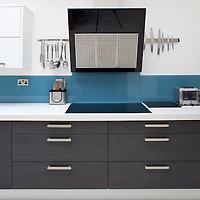white modern kitchen units and cooker hood Kitchen interiors