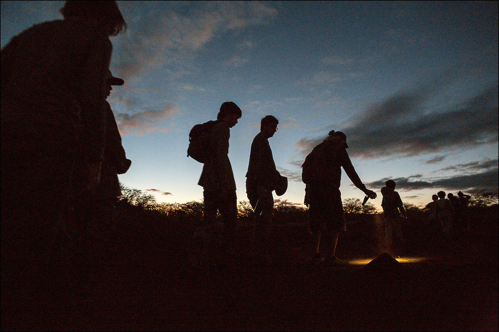 4:58am.  Dawn on the Kaupoa trail, West Molokai.  Brother Nolan holds light looking for tracks.