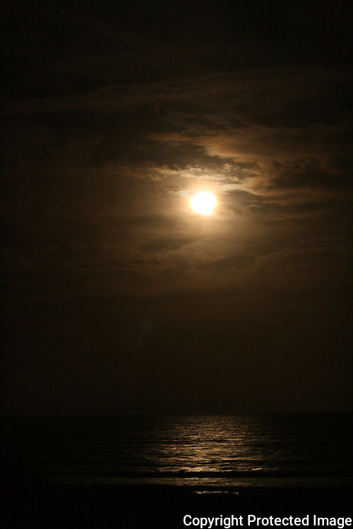 Ocean moonrise over a Jekyll Island beach in December.